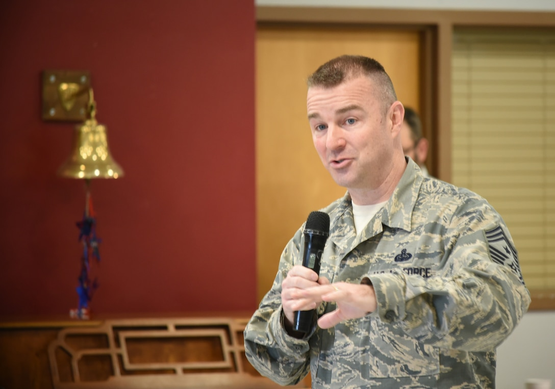 Chief Master Sgt. Gary Sharp, Air Force Sustainment Center command chief, poses a question to the Norman Veterans Center military panel during a Feb. 28, 2018, visit to the center in Norman, Oklahoma. The 15-member panel frequently visits area schools to share their military experiences and life lessons with students.
