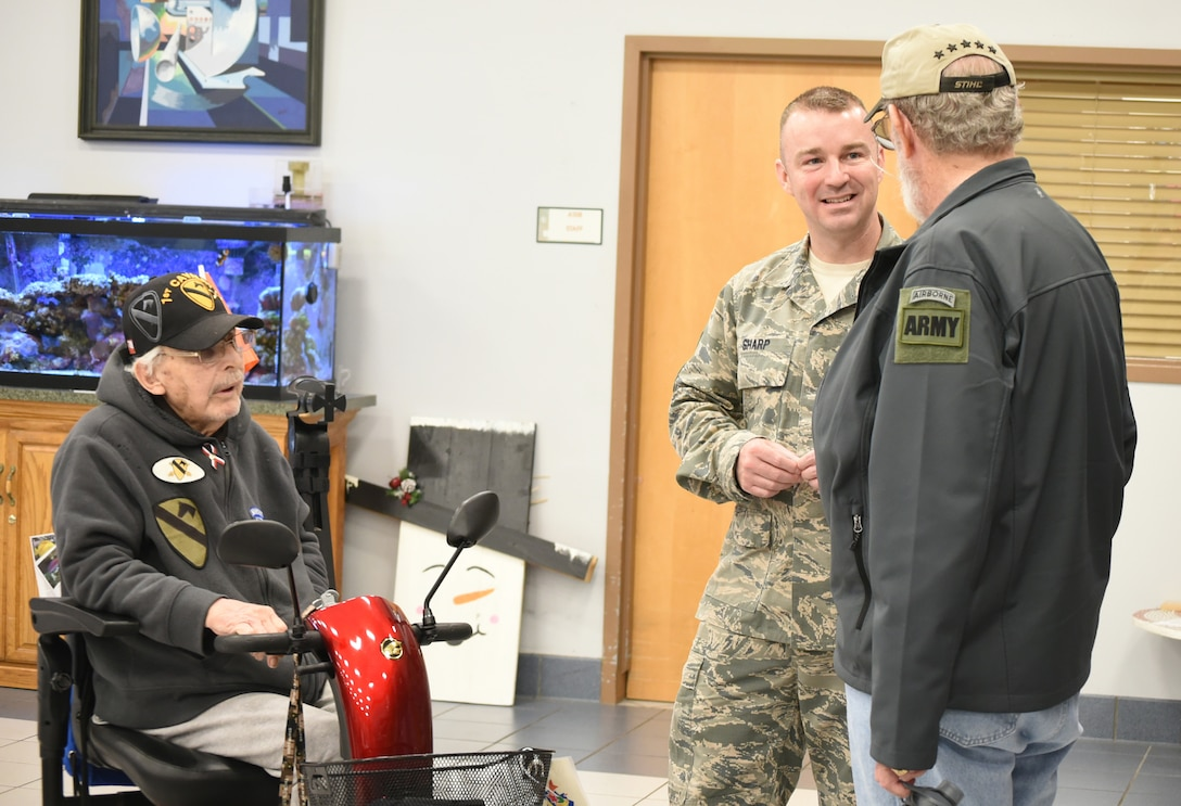 Chief Master Sgt. Gary Sharp, Air Force Sustainment Center command chief, visits with veterans Norman Tripp, left, and Patrick Farnon Feb. 28, 2018, at the Norman Veterans Center in Norman, Oklahoma.
