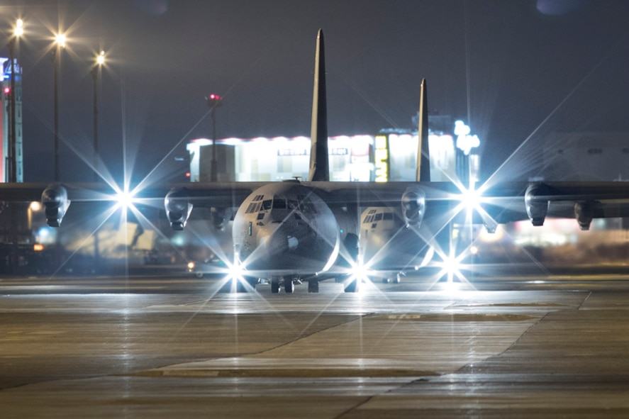 Two C-130J Super Hercules taxi on the runway