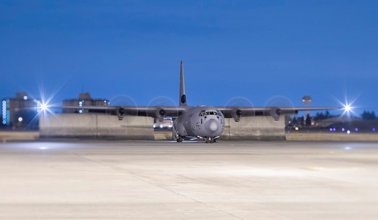 A C-130J Super Hercules waits to taxi down the flightline after returning a night training mission