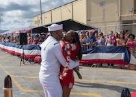 PEARL HARBOR (Mar. 7, 2018) A Sailor stationed aboard the Los Angeles-class fast attack submarine USS Tucson(SSN 770), is greeted by his loved one on the pier at Joint Base Pearl Harbor-Hickam after returning from a six-month Western Pacific deployment, Mar. 7. (U.S. Navy Photo by Mass Communication Specialist 2nd Class Shaun Griffin/Released)