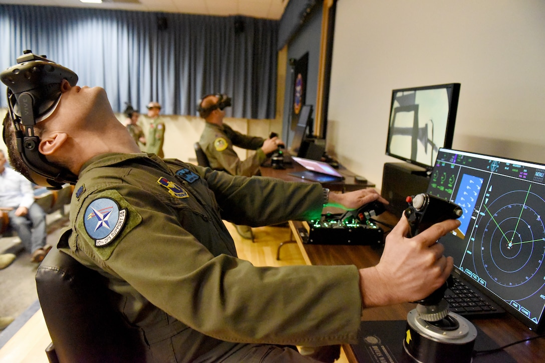 U.S. Air Force Lt. Col. Jason Turner, 80th Operations Support commander, looks up during a maneuver in a mixed reality flight simulator at Sheppard Air Force Base, Texas, March 7, 2018. The software, demonstrated by Flight Safety International, could be used in the future to enhance the undergraduate pilot training syllabus in the 80th Flying Training Wing. (U.S. Air Force photo by John Ingle)