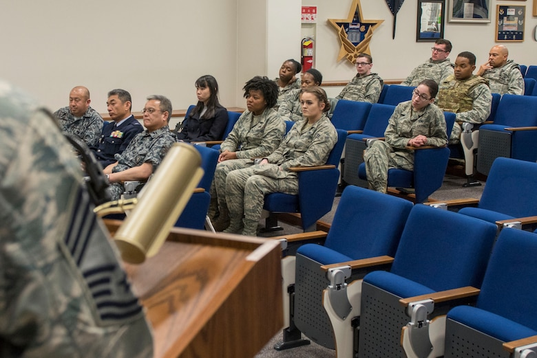 Airmen listening to the Women's History Month panel share their stories at Yokota Air Base, Japan, March 8, 2018.