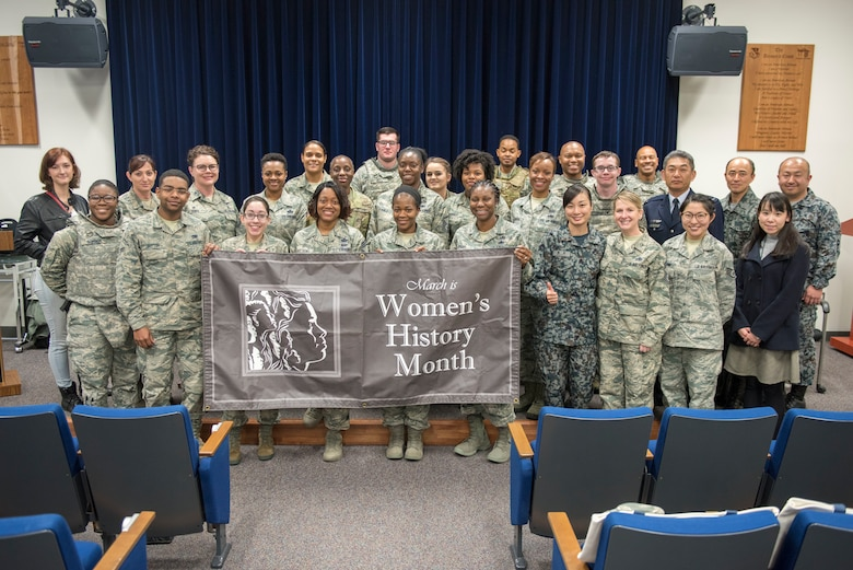 Attendents of the Women's History Month panel pose for a photograph at Yokota Air Base, Japan, March 8, 2018.