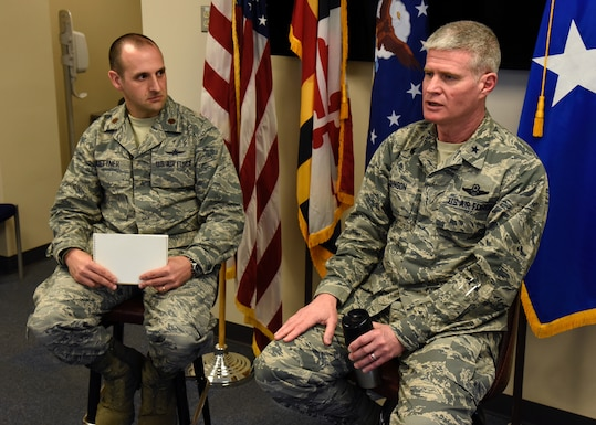 Air Force Brig. Gen. Paul Johnson, 175th Wing commander, answers questions given by Air Force Maj. Gary Huettner, 175th Communications Flight deputy commander, March 4th, 2018, at Warfield Air National Guard Base, Middle River, Md.