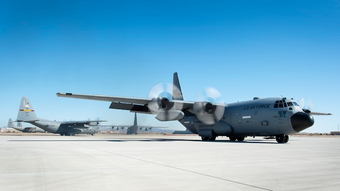 Three C-130 Hercules prepare to take off on an airdrop mission in Yuma, Ariz., Feb. 26, 2018.