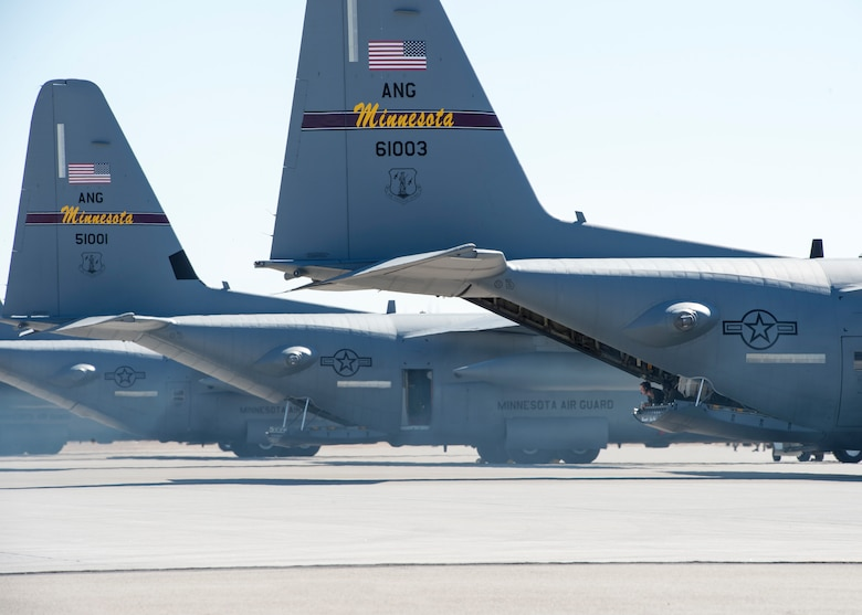 U.S. Air Force Staff Sgt. Timothy Hemquist, a load master with the 109th Airlift Squadron, watches and directs a C-130 Hercules pilot as the aircraft reverse taxis in Yuma, Ariz., Feb. 28, 2018.