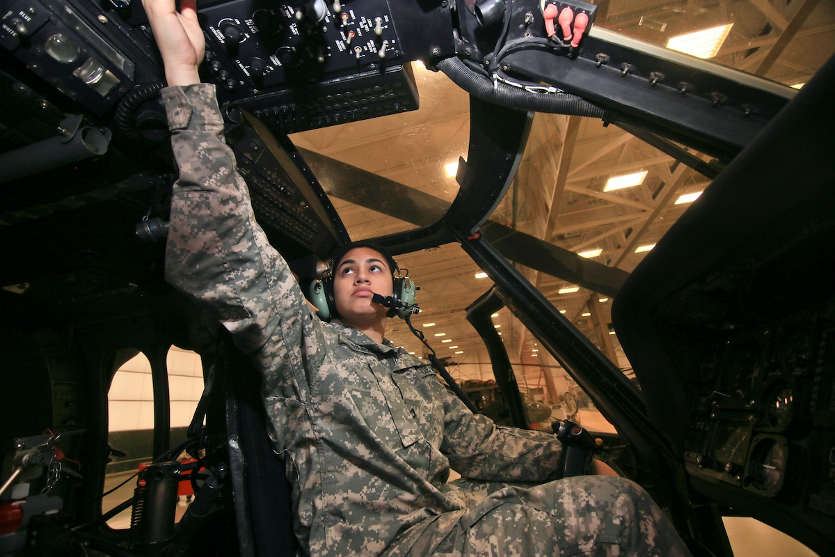 A soldier performs avionics checks on a UH-60L Black Hawk helicopter.