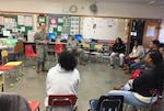 Air Force reservist speaks to local student-athletes.