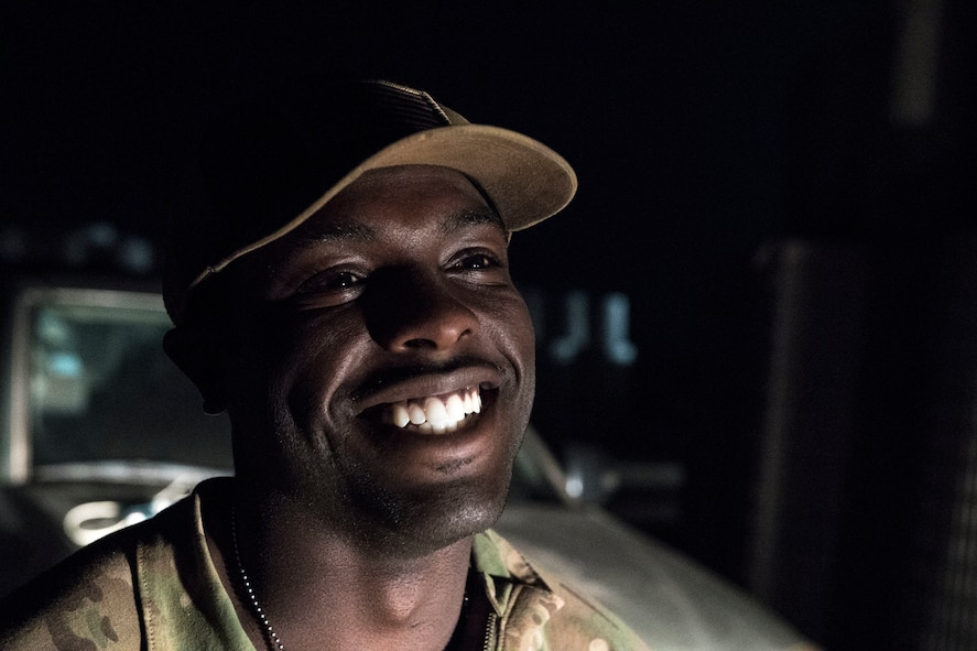 U.S. Air Force Staff Sgt. Mackenzie Isidor, 822nd Expeditionary Base Defense Squadron fire team leader, laughs during a night-shift conversation with one of cowrkers, Feb. 26, 2018, at Nigerien Air Base 201, in Agadez, Niger. Isidor inspires Airmen to consistently put in a conscientious effort to seek opportunities to succeed in the military. (U.S. Air Force photo by Tech. Sgt. Nick Wilson)