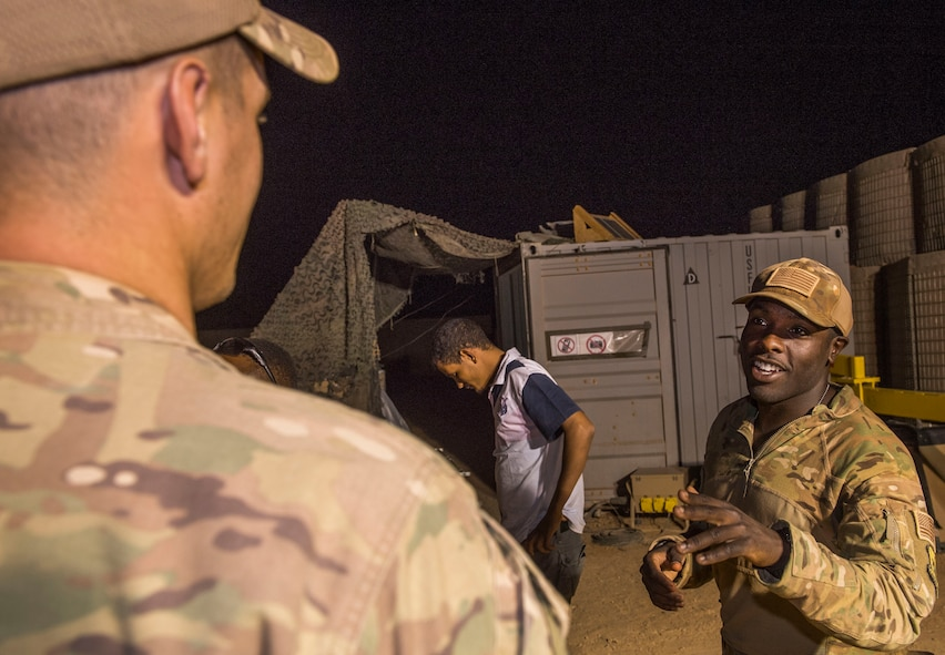 U.S. Air Force Staff Sgt. Mackenzie Isidor, 822nd Expeditionary Base Defense Squadron fire team leader, talks with Senior Airman Austen Gann, 822nd EBDS fire team member, during a night shift at Nigerien Air Base 201, in Agadez, Niger, Feb. 26, 2018. Isidor and Gann are deployed to Nigerien Air Base 201 from Moody Air Force Base, Georgia. (U.S. Air Force photo by Tech. Sgt. Nick Wilson)