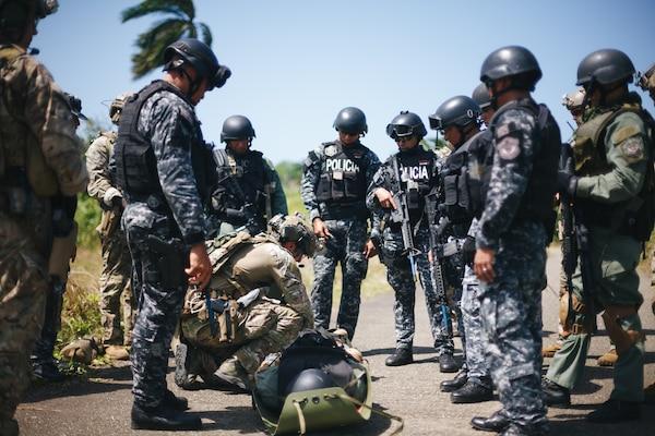 Military personnel train.