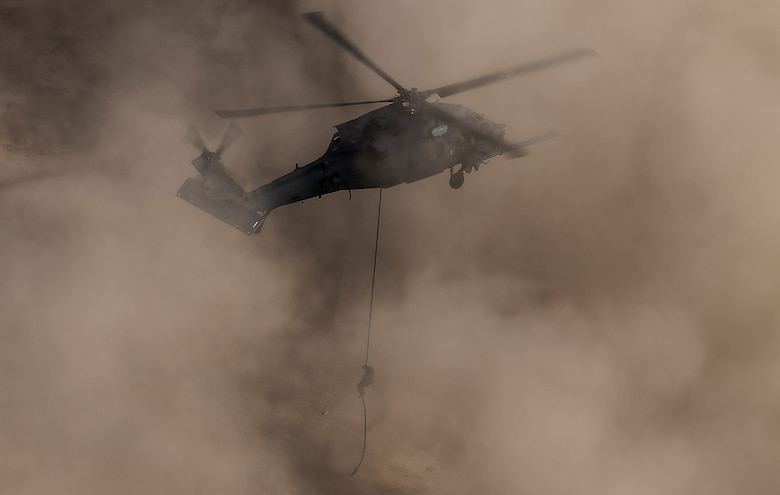 A pararescueman rappels out of an HH-60G Pave Hawk helicopter, assigned to the 66th Rescue Squadron, during training at Nellis Air Force Base, Nevada, Feb. 22, 2018. (U.S. Air Force photo by Senior Airman Kevin Tanenbaum)