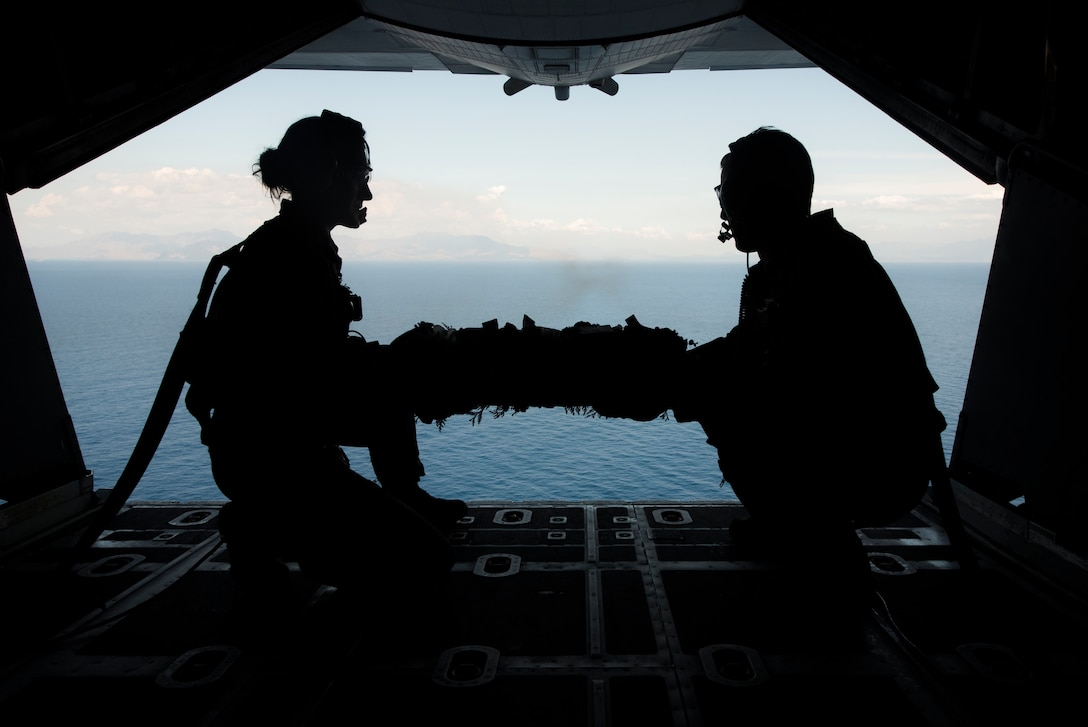 1st Special Operations Squadron loadmasters prepare to drop a wreath from an MC-130H Combat Talon II, during a memorial flight off the coast of the Philippines, Feb. 26, 2018. The flight honored those who were lost when a 1st SOS MC-130E, call sign STRAY 59, crashed 37 years ago during an exercise, killing eight members of the crew and 15 passengers. (U.S. Air Force photo by Staff Sgt. Matthew B. Fredericks)