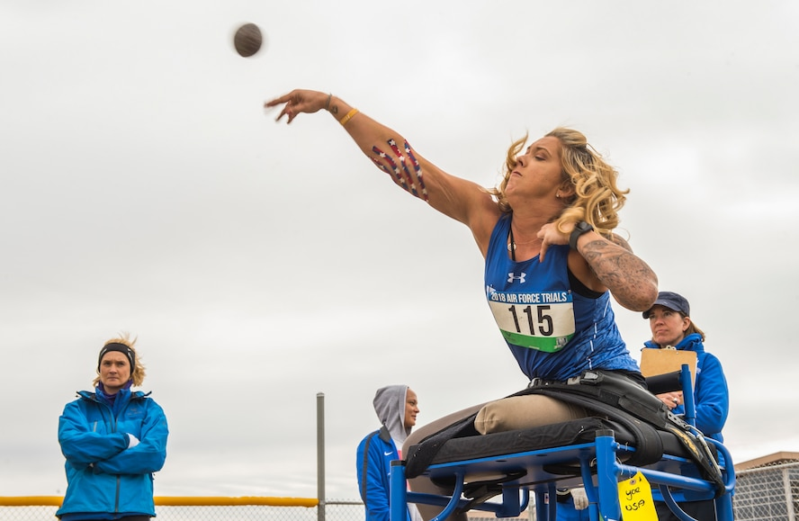 Senior Airman Heather Carter, a wounded warrior athlete, throws a shot put during the track and field competition at the 5th Annual Air Force Wounded Warrior Trials at Nellis Air Force Base, Nev., Feb. 27, 2018. The Air Force Trials is an adaptive and resiliency sports event designed to promote the mental and physical well-being of the participants. (U.S. Air Force photo by Senior Airman James R. Crow)