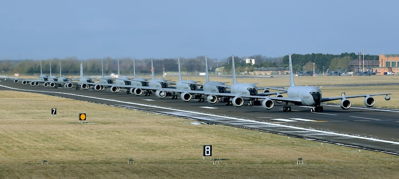 Twelve U.S. Air Force KC-135 Stratotankers, assigned to the 100th Air Refueling Wing, taxi down the runway at RAF Mildenhall, England, Feb. 27, 2018. The show of force maneuver demonstrated the readiness of the wing to provide global air refueling support at short notice. (U.S. Air Force photo by Senior Airman Justine Rho)