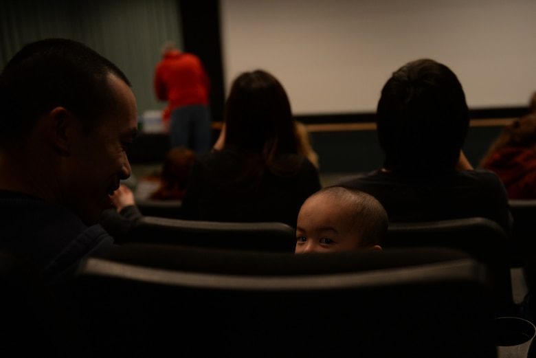 Tech. Sgt. Huy Nguyen, a senior weapons system controller assigned to the 28th Maintenance Group, and his family attend a movie and dinner during a Hearts Apart event at the Elks Theater in Rapid City, S.D., March 3, 2018. The Airman and Family Readiness Center at Ellsworth Air Force Base, S.D., hosted the event to help bring together families facing deployed or soon-to-be deployed parents and spouses.  (U.S. Air Force photo by Airman 1st Class Nicolas Z. Erwin)