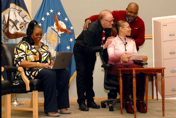 Employees from DLA Troop Support act out a scenario supporting the Leadership SAPR Summit.