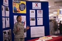 Maj. Tamekia Payne, 366th Force Support Squadron operations officer, speaks about her mentors at a cake cutting and recognition ceremony during International Women's Day March 8, 2018, at Mountain Home Air Force Base, Idaho. Women's History Month, recognizes the great contributions that women have made to our nation. (U.S. Air Force photo by Senior Airman Lauren-Taylor Levin)