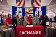 Col. Scott Grover, 366th Maintenance Group commander, and members of the base community participated in a cake cutting and recognition ceremony during International Women's Day March 8, 2018, at Mountain Home Air Force Base, Idaho. International Women's Day recognizes women for their achievements without regards to divisions, whether national, ethnic, linguistic, cultural, economic and political. (U.S. Air Force photo by Senior Airman Lauren-Taylor Levin)