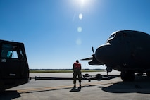 Airmen from the 71st Aircraft Maintenance Unit tow an HC-130J Combat King II during an aircraft pull challenge, March 9, 2018, at Moody Air Force Base, Ga. The challenge was part of a Comprehensive Airman Fitness super sports day event where the 71st AMU and 41st Helicopter Maintenance Unit faced off for bragging rights. (U.S. Air Force Photo by Senior Airman Janiqua P. Robinson)