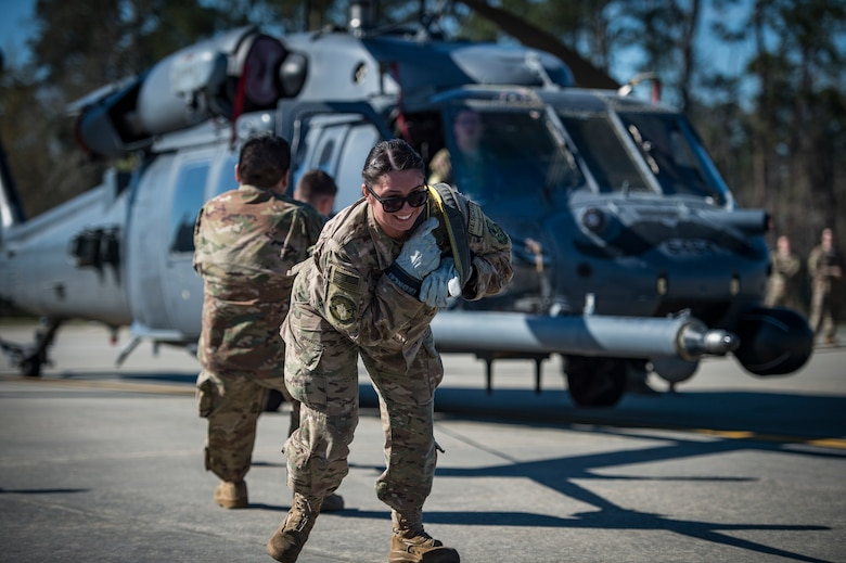 Airmen from the 71st Aircraft Maintenance Unit pull an HH-60G Pave Hawk helicopter during an aircraft pull challenge, March 9, 2018, at Moody Air Force Base, Ga. The challenge was part of a Comprehensive Airman Fitness super sports day event where the 71st AMU and 41st Helicopter Maintenance Unit faced off for bragging rights. (U.S. Air Force Photo by Senior Airman Janiqua P. Robinson)