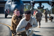 Airmen from the 71st Aircraft Maintenance Unit pulls an HC-130J Combat King II during an aircraft pull challenge, March 9, 2018, at Moody Air Force Base, Ga. The challenge was part of a Comprehensive Airman Fitness super sports day event where the 71st AMU and 41st Helicopter Maintenance Unit faced off for bragging rights. (U.S. Air Force Photo by Senior Airman Janiqua P. Robinson)