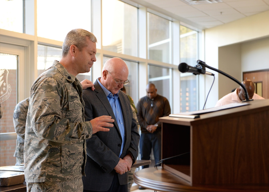 Chaplain (Lt. Col.) Steven Richardson, 14th Flying Training Wing Chaplain, and his father Retired Maj. Gen., Cecil Richardson, former Air Force Chief of Chaplains speak in prayer together March 6, 2018, on Columbus Air Force Base, Mississippi. Cecil Richardson spoke at six separate Squadron areas throughout the base's National Prayer Breakfast week. (U.S. Air Force photo by Airman 1st Class Keith Holcomb)