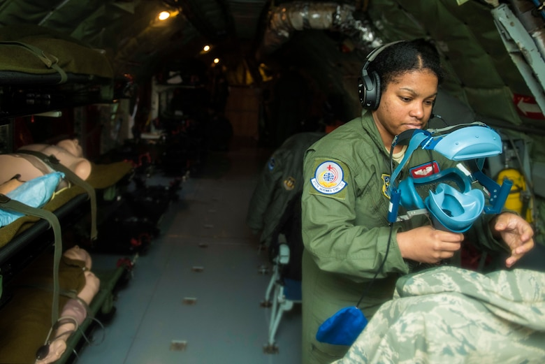 Staff Sgt. Raymeisha Childs, 375th Aeromedical Evacuation Squadron aeromedical technician, checks an oxygen mask during an aeromedical evacuation training at Fairchild Air Force Base, Washington, March 1, 2018. It is essential for all medical equipment to be functioning properly to provide critical care for each patient during transport. (U.S. Air Force photo/Airman 1st Class Whitney Laine)