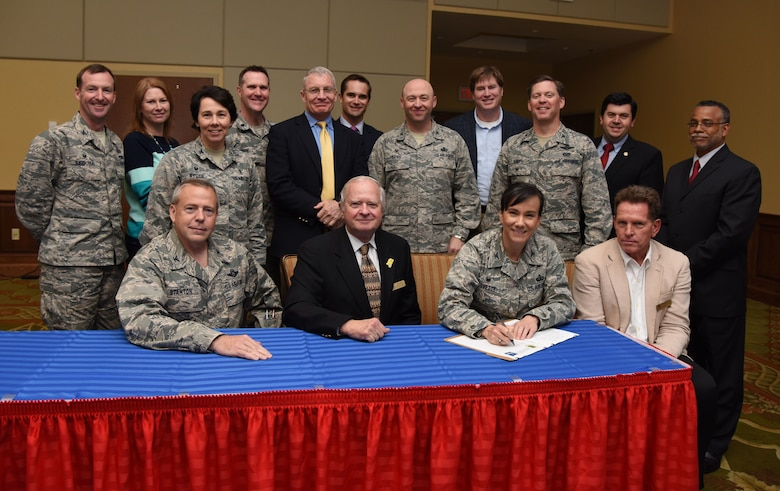 Col. Debra Lovette, 81st Training Wing commander, signs a memorandum of understanding between the 81st TRW and Mississippi Gulf Coast Community for the Keesler Community Partnership Program Agreement at the Bay Breeze Event Center March 7, 2018, on Keesler Air Force Base, Mississippi. The signing establishes a community partnership program on behalf of Keesler AFB mission partners with the Mississippi Gulf Coast community and local governments. (U.S. Air Force photo by Kemberly Groue)