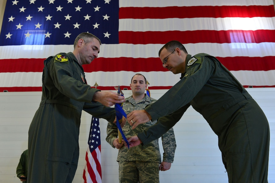 Col. Joseph, 432nd Operations Group commander and Lt. Col. Nicholas, 15th Attack Squadron commander case the 15th Expeditionary ATKS guidon March 9, 2018, at Creech Air Force Base, Nev. The final MQ-1 Predator combat line was flown in an undisclosed area of responsibility by Airmen of the 15th ATKS during the official MQ-1 retirement ceremony. (U.S. Air Force photo by Airman 1st Class Haley Stevens)