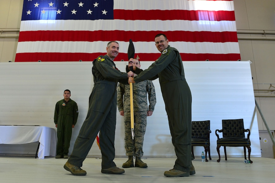 Col. Joseph, 432nd Operations Group commander and Lt. Col. Nicholas, 15th Attack Squadron commander pose for a photo after casing the 15th ATKS guidon March 9, 2018, at Creech Air Force Base, Nev. The final MQ-1 Predator combat line was flown in an undisclosed area of responsibility by Airmen of the 15th ATKS during the official MQ-1 retirement ceremony. (U.S. Air Force photo by Airman 1st Class Haley Stevens)