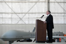 "Mr. James G. ""Snake"" Clark, the director, Intelligence, Surveillance and Reconnaissance, Modernization and Infrastructure and Deputy Chief of Staff for ISR, Headquarters U.S. Air Force, speaks at the MQ-1 Predator retirement ceremony March 9, 2018, at Creech Air Force Base, Nev. Clark played a role in the Air Force acquisition of the MQ-1 Predator and has seen it through many developments, including arming it with munitions, evolving its mission set from ISR to persistent attack. (U.S. Air Force photo by Senior Airman James Thompson)"