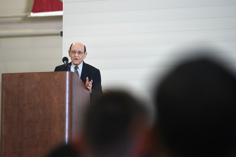 "Mr. Abraham Karem, president of Karem Aircraft Incorporated, speaks during the MQ-1 Predator retirement ceremony March 9, 2018, at Creech Air Force Base, Nev. Karem is considered the ""father"" of the MQ-1 for having built an earlier model of what later evolved into the MQ-1 in his home garage. (U.S. Air Force photo by Senior Airman James Thompson)"