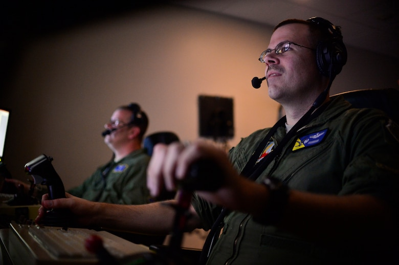 Lt. Col. Nicholas, 15th Attack Squadron commander, and Senior Master Sgt. Westley, 15th ATKS superintendent, fly the last MQ-1 Predator combat line, March 9, 2018, at Creech Air Force Base, Nev. Airmen have operated the MQ-1 for more than 20 years and provided intelligence, surveillance, reconnaissance and strike capabilities to the fight 24/7/365 across multiple areas of responsibilities. (U.S. Air Force photo by Senior Airman Christian Clausen)