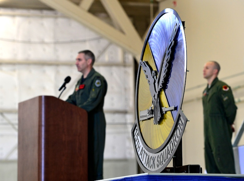 Col. Joseph, 432nd Operations Group commander, delivers remarks for the 15th Attack Squadron's casing ceremony March 9, 2018, at Creech Air Force Base, Nev. The final MQ-1 Predator combat line was flown in an undisclosed area of responsibility by Airmen of the 15th ATKS during the official MQ-1 retirement ceremony. (U.S. Air Force photo by Senior Airman Christian Clausen)