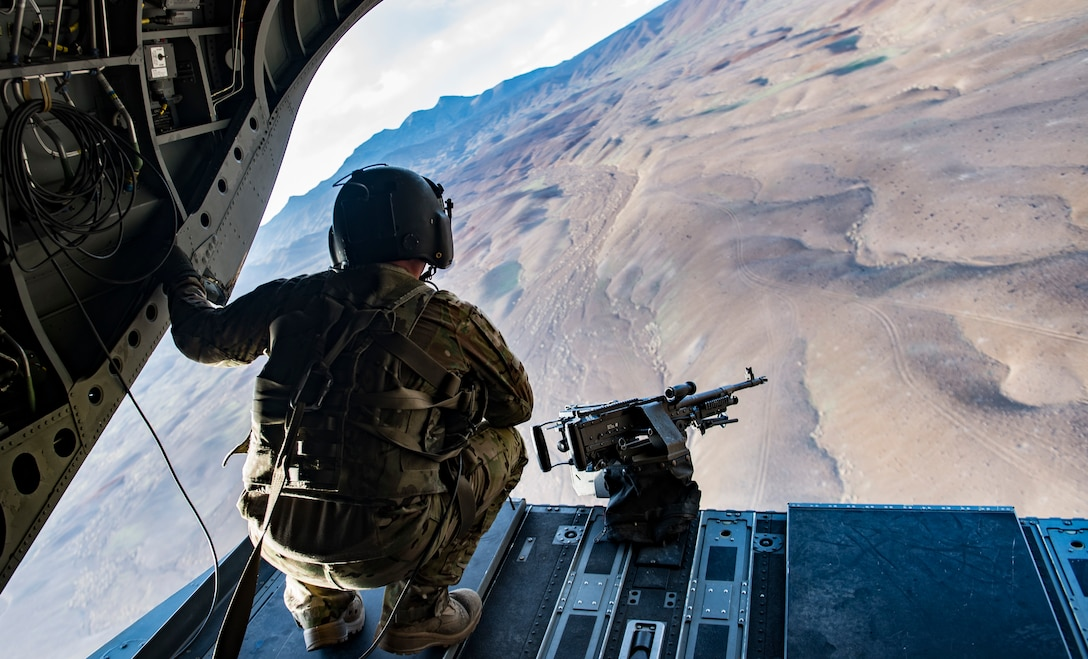 A U.S. Army Task Force Brawler flight engineer mans the ramp gun of a CH-47F Chinook to provide overwatch while conducting a personnel recovery exercise with a Guardian Angel team assigned to the 83rd Expeditionary Rescue Squadron at Bagram Airfield, Afghanistan, March 6, 2018.