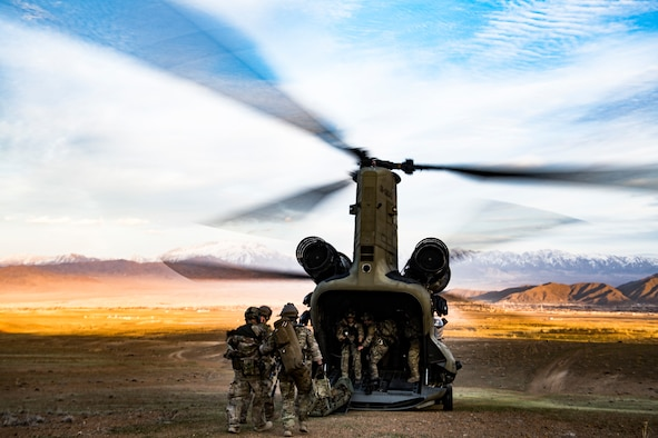 U.S. Air Force pararescuemen, assigned to the 83rd Expeditionary Rescue Squadron, load simulated casualties on board a CH-47F Chinook, flown by members of U.S. Army Task Force Brawler, during a personnel recovery exercise at an undisclosed location in Afghanistan, March 6, 2018.
