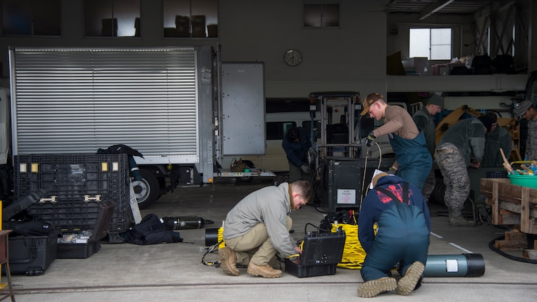 U.S. Navy and U.S. Air Force personnel prepare equipment at Lake Ogawara, Tohoku Town, Japan, March 10, 2018.