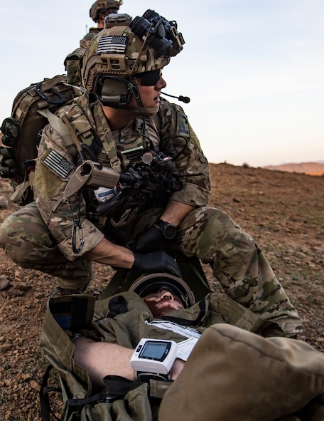 A U.S. Air Force pararescueman, assigned to the 83rd Expeditionary Rescue Squadron, prepares to move a simulated casualty during a personnel recovery exercise at an undisclosed location in Afghanistan, March 6, 2018. Army aircrews and Air Force Guardian Angel teams conducted the exercise to build teamwork and practice procedures as they provide joint personnel recovery capability, aiding in the delivery of decisive airpower for U.S. Central Command. (U.S. Air Force Photo by Tech. Sgt. Gregory Brook)