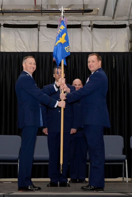 Lt. Col. Mark W. Ustaszewski (right) accepts the 157th Operations Group guidon from Col. James Ryan, commander 157th Air Refueling Wing during a change of command ceremony at Pease Air National Guard Base, N.H., March 10, 2018. The change of commmand cermony represents a formal transfer of authority and responsibility from an outgoing commander to the incoming commander.(N.H. Air National Guard photo by Senior Airman Taylor Queen)