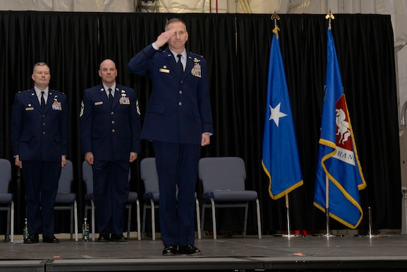 Col. James P. Ryan, commander 157th Air Refueling Wing, renders a final salute to the Airmen of the 157th during a change of command ceremony at Pease Air National Guard Base, N.H., March 10, 2018. Col. John W. Pogorek assumed command of the 157th ARW during this ceremony.(N.H. Air National Guard photo by Senior Airman Taylor Queen)
