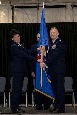 Col. John W. Pogorek (right) accepts the 157th Air Refueling Wing guidon from Brig. Gen. Laurie M. Farris during a change of command ceremony at Pease Air National Guard Base, N.H., March 10, 2018. The change of commmand cermony represents a formal transfer of authority and responsibility from an outgoing commander to the incoming commander.(N.H. Air National Guard photo by Senior Airman Taylor Queen)