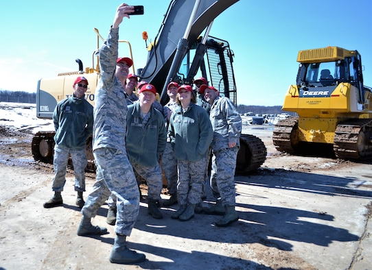 Chief Master Sgt. Ronald C. Anderson, command chief master sergeant of the Air National Guard, takes a selfie with members of the 201st Rapid Engineer Deployable Heavy Operational Repair Squadron Engineer Squadron, Det. 1, and Lt. Gen. L. Scott Rice, director of the ANG, Horsham Air Guard Station, March 11, 2018. The lieutenant general and command chief master sergeant received some hands-on experiences with the missions of various units in the 111th Attack Wing. (U.S. Air National Guard photo by Tech. Sgt. Andria Allmond)