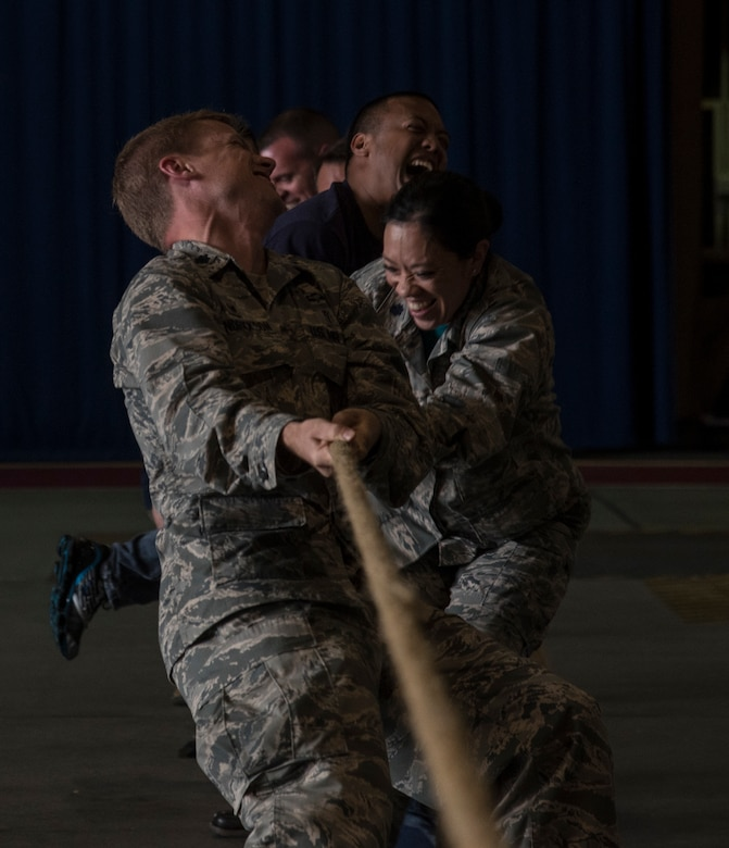The 35th Fighter Wing leadership participates in a tug-o-war challenge during the first Team Misawa Resilient Relationships and Appreciation Day, at Misawa Air Base, Japan, Aug. 18, 2017. The event, hosted by the 35th Fighter Wing Chapel Corps, afforded personnel an opportunity to see their squadron leaders participate in a resiliency challenge as they closed out the day leading by example. According to Air Force assessments on Airmen, ensuring all personnel exercise mental, physical, social and spiritual activities in their life, in and out of work, leads to a well-performing, mission ready Airmen who can better execute tasks. (U.S. Air Force photo by Senior Airman Sadie Colbert)