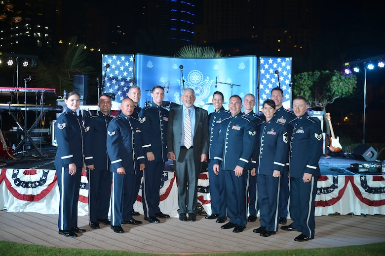 U.S. Air Forces Central Command band poses with Paul R. Malik, U.S. Consul General during the U.S. National Day celebration March 7, 2018 at the Ritz-Carlton Hotel and Resort, Dubai. The AFCENT band is a popular music ensemble comprised of American Airman who are charged with using music to bring diverse peoples from different cultures together to engender mutual appreciation and respect.(U.S. Air Force Photo by Tech Sgt. Anthony Nelson Jr. )