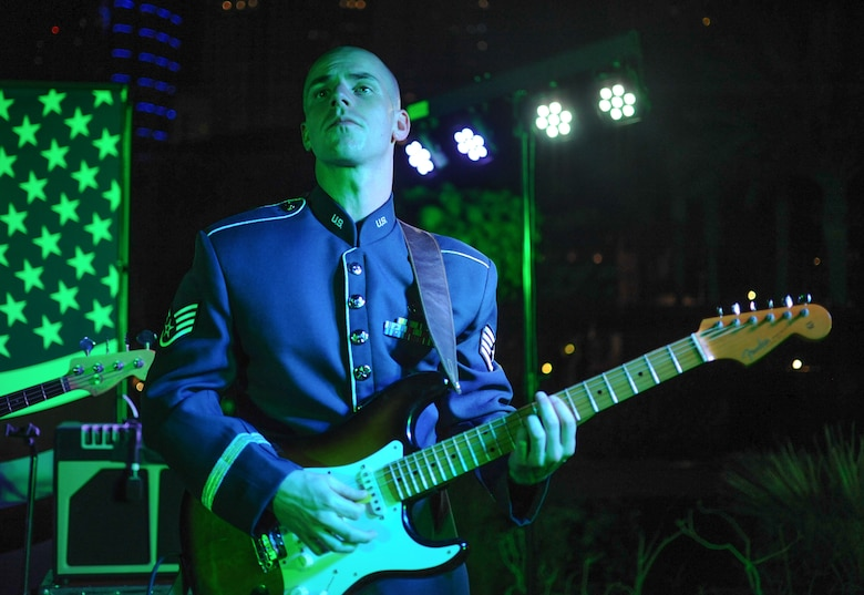 U.S Air Force Staff Sgt. Andrew Thompson, U.S. Air Forces Central Command band member performs during the United States National Day March 7, 2018 at the Ritz-Carlton Hotel and Resort, Dubai. The band collaborates with U.S. Embassies throughout southwest Asia to share American culture, build partnerships and develop relationships. (U.S. Air National Guard Photo by Staff Sgt. Colton Elliott)