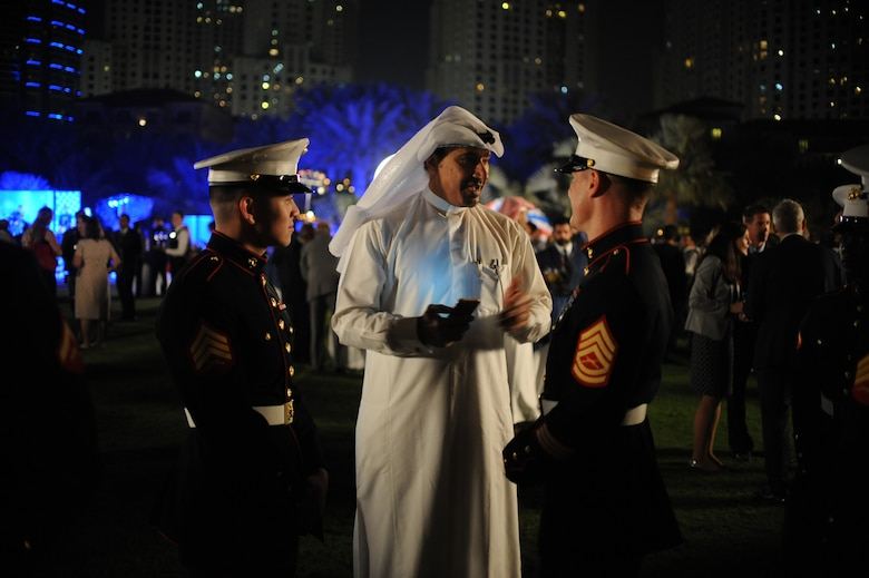 U.S. Marines deployed to the United Arab Emirates talk with Emirates during the United States National Day March 7, 2018 at the Ritz-Carlton Hotel and Resort, Dubai. Strengthen Allies & Partnerships is one of the U.S. Central Commands top priorities in the region. (U.S. Air National Guard Photo by Staff Sgt. Colton Elliott)