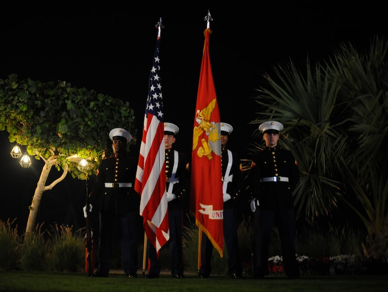 U.S. Marines deployed to the United Arab Emirates present the U.S. Flag during the U.S. National Day March 7, 2018 at the Ritz-Carlton Hotel and Resort, Dubai. The United States Independence Day is celebrated in the early months of the year for citizens to take advantage of cooler weather. (U.S. Air National Guard Photo by Staff Sgt. Colton Elliott)