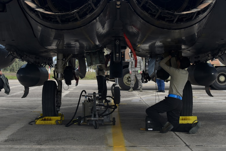 An Airman assigned to the 492nd Aircraft Maintenance Unit performs post-flight checks on an F-15E Strike Eagle at Andravida Air Base, Greece, March 7. The F-15s are scheduled to participate in INIOHOS 18, a Hellenic Air Force-led multinational exercise that enhances interoperability, capabilities and skills between allied and partner air forces. (U.S. Air Force photo/Airman 1st Class Eli Chevalier)